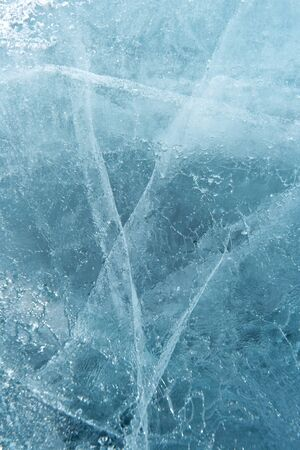 Beautiful ice of Lake Baikal with abstract cracks Stock Photo