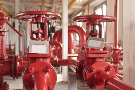 Two red valve at plant on oil refining and gas Stock Photo - 14240130
