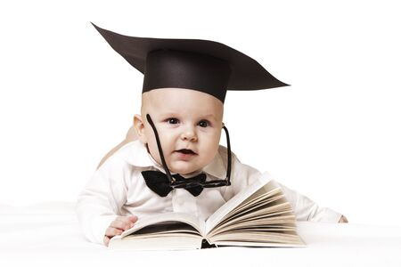 Baby in academician clothes with book