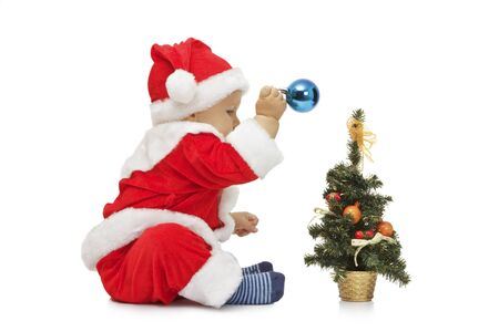 The beautiful little boy in suit of Santa Claus Isolated on white background photo