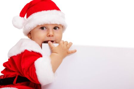 Small Santa with the poster in hands sits photo