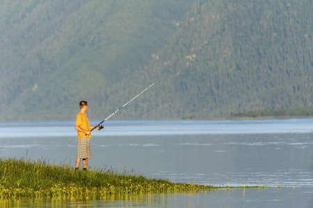 ashore: Beautiful reservoir in Siberia and the fisherman ashore Stock Photo