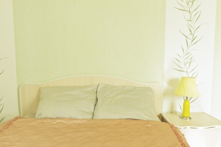 Empty pure bed with a cover in light room