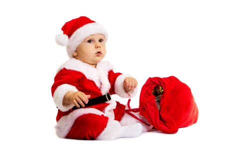 christmas baby: The boy in dress of Santa Claus isolated on white background Stock Photo