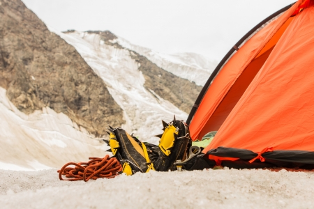 Feet of the person in special footwear for mountains from tent Stock Photo - 17644208