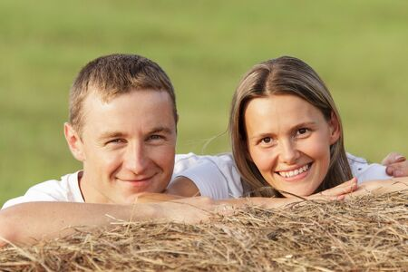 tenderly: The guy tenderly embraces the girl for shoulders Stock Photo