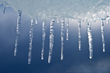 Vertical icicles flowing down from an ice floe Stock Photo - 17755590