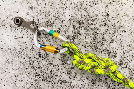 carabiner: Climbing equipment on an ice site of way. Top view Stock Photo