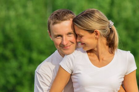 The guy tenderly embraces the girl for waist Stock Photo - 18205489