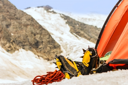 Equipment of climber near tent in which he has rest photo