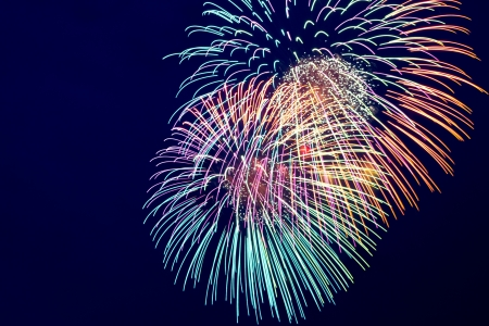 fireworks background: Brightly colorful fireworks and salute of various colors in the night sky