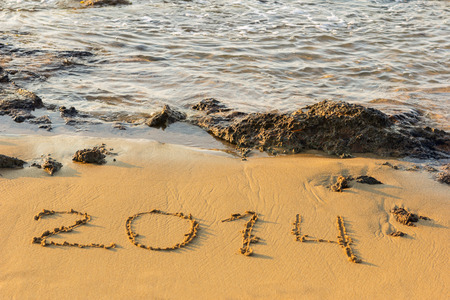 The sea coast with stones and figures of new year photo
