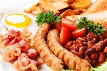 cooked sausage: Breakfast from fried eggs of bacon of beans with tomatoes