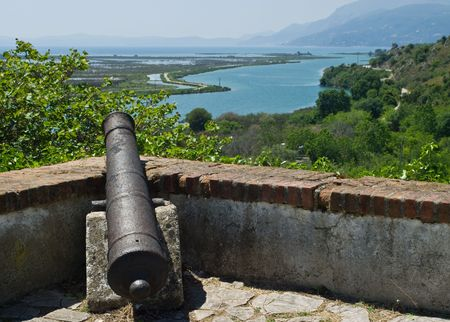 gunnery: Old cannon at Butrint fortress in Albania.