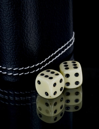 Two standard six-sided pipped dice with rounded corners on black background. Stock Photo - 8485926