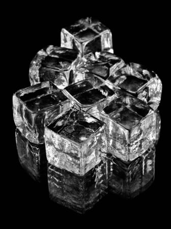 Glass cubes on black background with reflections. photo