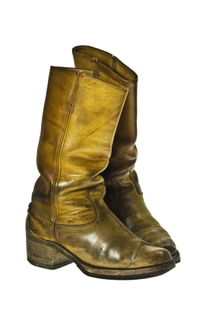 Old worn cowboy style boots from the seventies of the twentieth century - isolated Stock Photo