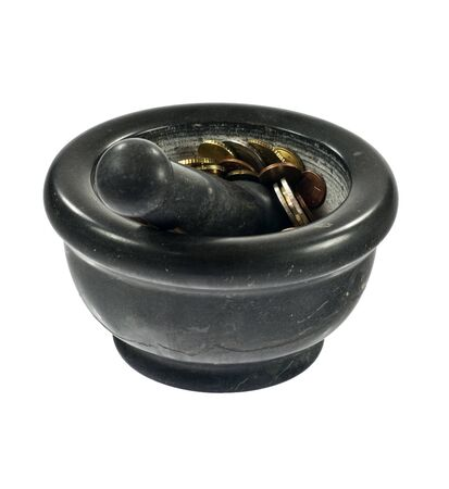 Crushing money in stone mortar on white background Stock Photo