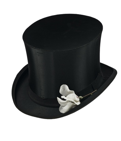 Black top hat and white magnolia flower isolated Stock Photo