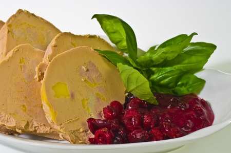 Sliced foie gras with cumberland sauce and basil leaves