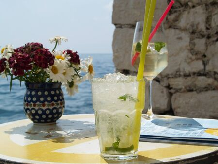 colada: Pina Colada and Hugo - two summer drinks by the sea