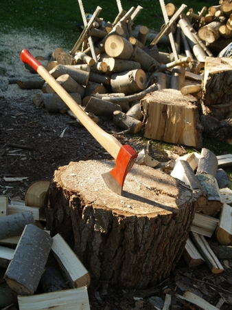 Cleaver with chopping block and wood Stock Photo