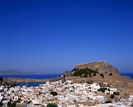View looking over the town of Lindos, Rhodes, Greece with the castle in the background. photo