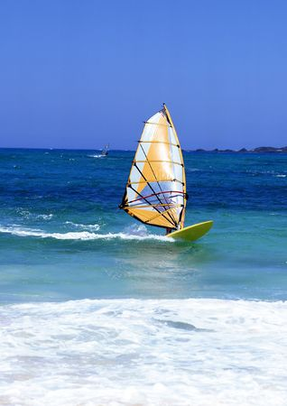 exhilarating: Windsurfer on Lanzarote, Canary Islands in a turquoise sea with white surf Stock Photo