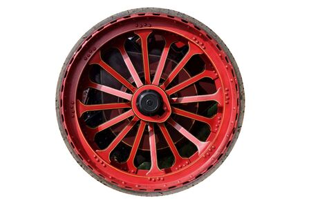 traction: Isolated steam traction engine wheel, red with thin rubber tyre