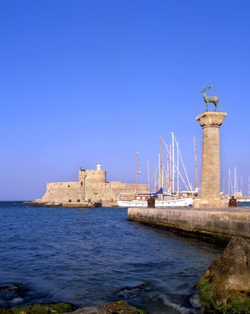 rhodes: Rhodian deer atop the columns that protect Mandraki harbour entrance, on the Greek island of Rhodes