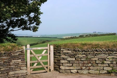drystone: Entry into a field through gate in a traditional dry-stone wall