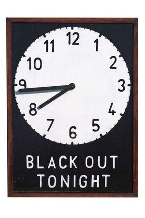 warden: A Second World War sign giving details of the time of the Black Out during which time no light should be shown outside of buildings Stock Photo