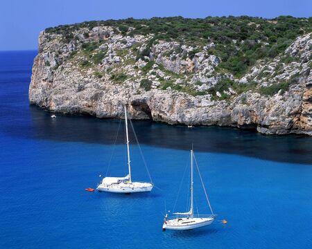 Two sail boats in the bay of Paleokastritsa on the greek island of Corfu