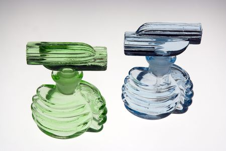 A green and light blue antique perfume (scent) bottles. Glass with stoppers photo