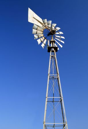 An irrigation wind pump against a blue sky Stock Photo - 4284041