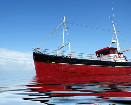 trawler: Bright red fishing boat at sea