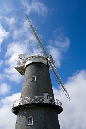 traditional windmill: Traditional windmill set against blue sky