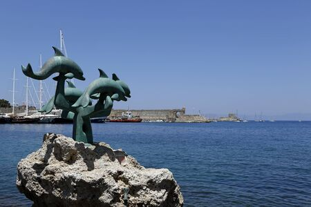 rhodes: The dolphin statue outside the old town of Rhodes, Greece Stock Photo