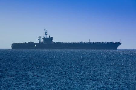 a battleship: Aircraft Carrier docked outside Rhodes, Greece
