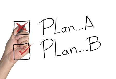 Hand Wahl der Strategie mit dem zweiten Plan Standard-Bild - 10558105
