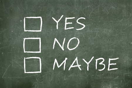 maybe: yes, no or maybe on a green blackboard