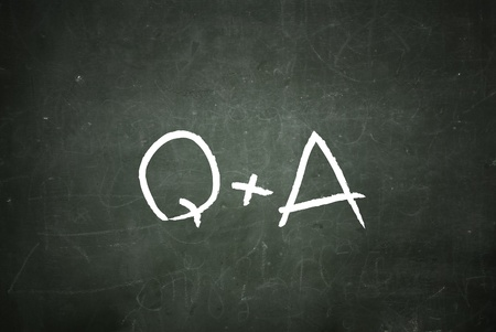 Writing Q&A, Questions and Answers on a blackboard. photo