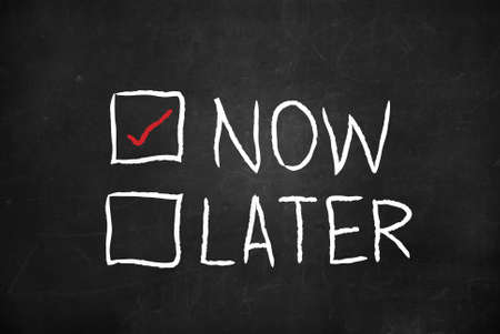 Now and Later check boxes on blackboard Stock Photo - 12404763