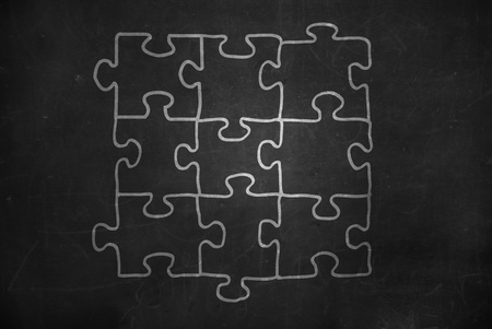 jigsaw on blackboard Stock Photo - 12938545