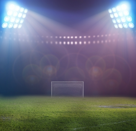 campeonato de futbol: luces del estadio en la noche