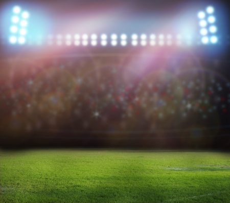 soccer ball on grass: stadium lights at night and stadium Stock Photo