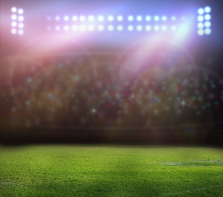 cancha deportiva futbol: luces del estadio en la noche y el estadio