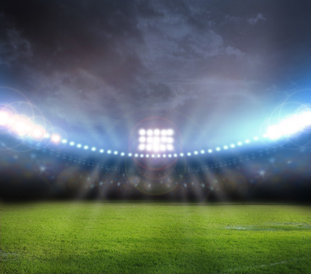 soccer ball on grass: stadium lights Stock Photo