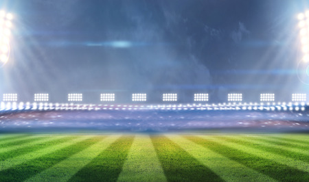 Green soccer stadium, illuminated field, arena in night photo