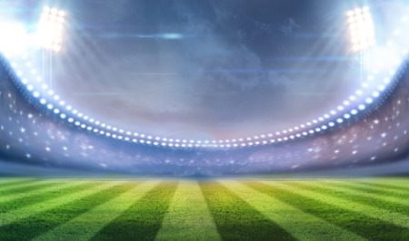 campeonato de futbol: luces en la noche y el estadio